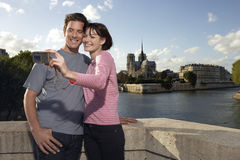 Couple Photographing Themselves In Front Of Notre Dame Cathedral Stock Images