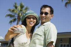 Couple photographing themselves outdoors Stock Photography