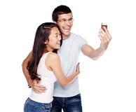 Couple photographing themselves Stock Photo