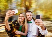 Couple photos with mobile Stock Photo