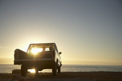 Couple In Pick-Up Truck Enjoying Sunset Stock Photos