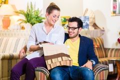 Couple picking armchair seat cover in furniture store Royalty Free Stock Image