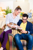 Couple picking armchair seat cover in furniture store Stock Image