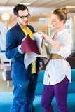 Couple picking couch seat cover in furniture store Royalty Free Stock Photo