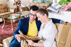 Couple picking couch seat cover in furniture store Royalty Free Stock Image