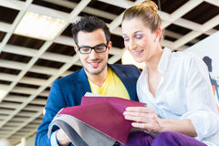 Couple picking couch seat cover in furniture store Stock Image