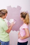 Couple picking paint colors Royalty Free Stock Image
