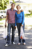Couple Picking Up Litter In Suburban Street Stock Photo