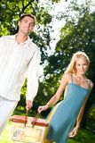 Couple with picnic basket Stock Photos