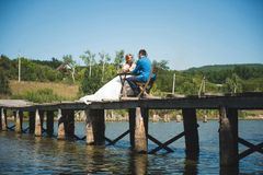 Couple at Picnic on Bridge. Couple having picnic at table on bridge Royalty Free Stock Photo