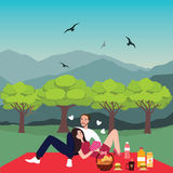 Couple picnic man woman in park outdoor dating bring food basket Royalty Free Stock Photos