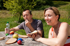 Couple at a picnic in nature Stock Photography