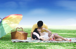 Couple picnic in the park. Romentic young couple picnic together in the park stock image