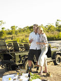 Couple On Picnic During Safari By Jeep Royalty Free Stock Photo