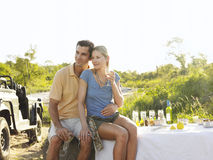 Couple On Picnic During Safari By Jeep Stock Image