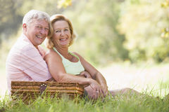 Couple at a picnic smiling Stock Image