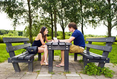 Couple at picnic table Royalty Free Stock Image