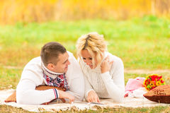 Couple on a picnic together reading novel Stock Photos