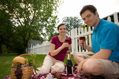 Couple on Picnic With Wine Glasses-Horizontal Stock Photography