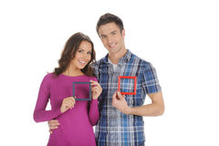 Couple with picture frames. Royalty Free Stock Image