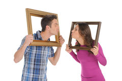Couple with picture frames. Royalty Free Stock Photo