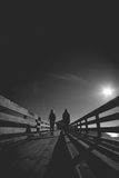 Couple on pier in the moonligh Royalty Free Stock Photos