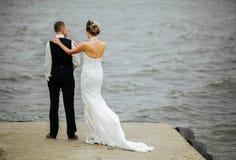 Couple on pier Stock Image