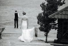 Couple on pier Stock Photo