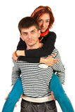 Couple piggy back ride Stock Image