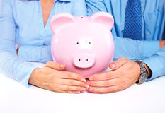 Couple with a piggy bank. Royalty Free Stock Image