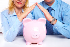 Couple with a piggy bank. Royalty Free Stock Photo