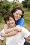 Couple piggyback Stock Photo