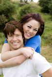Couple piggyback stock photography