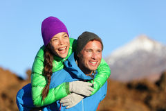Couple piggyback happy in active lifestyle Royalty Free Stock Image