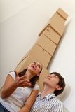 Couple with a pile boxes Royalty Free Stock Photos