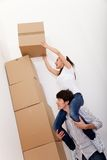 Couple piling boxes Royalty Free Stock Images