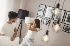 Couple in a pillow fight royalty free stock image