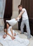 Couple pillow fight. Stock Photo