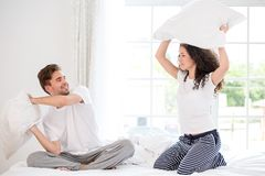 Couple pillow fighting Stock Images