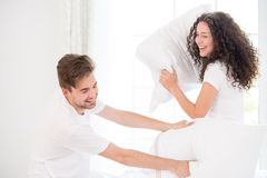 Couple pillow fighting Stock Photos