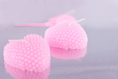 The couple of pink candles in the shape of heart Royalty Free Stock Images