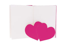 Couple pink paper heart on blank open book isolated on white royalty free stock images