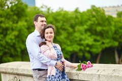 Couple with pink roses outdoors. Young romantic couple with pink roses outdoors Royalty Free Stock Photo