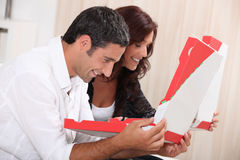 Couple with  pizza boxes Royalty Free Stock Photo