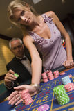 Couple placing bet at roulette table. In casino Stock Images