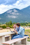 Couple plan a vacation trip route and booking hote Stock Images