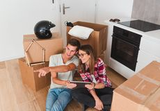 Couple planning furniture relocation royalty free stock image