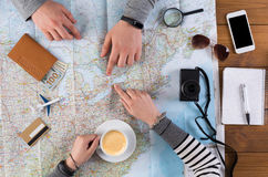 Couple planning travel to Toronto, Canada. Couple planning trip to Toronto, Canada, pointing on this city on map. Travel background with accessories royalty free stock image