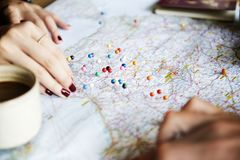 Couple planning for trip with the help of map royalty free stock photography