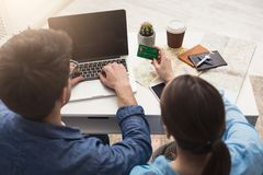 Couple planning trip, searching and paying online royalty free stock photo